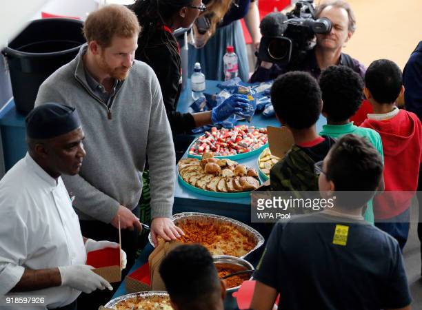 Prince Harry serves pasta as he visits a Fit and Fed February school holiday activity programme at the Roundwood Youth Centre on February 15 2017 in...