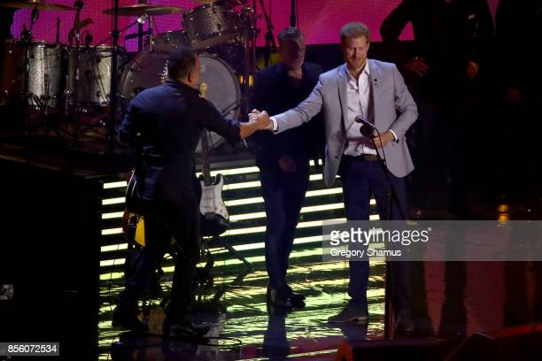 Prince Harry shakes hands with American singersongwriter Bruce Springsteen during the closing ceremony of the Invictus Games 2017 at Air Canada...
