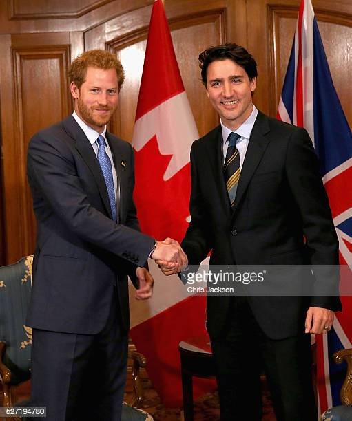 Prince Harry shakes hands with Canadian Prime Minister Justin Trudeau as he attends a bilateral meeting at the Fairmont Royal York Hotel on May 2...