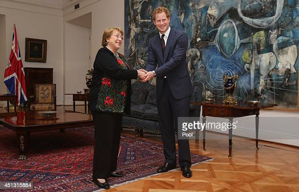 Prince Harry shakes hands with Chilean President Michelle Bachelet as he visits the La Moneda Presidential Palace on June 27 2014 in Santiago Chile...