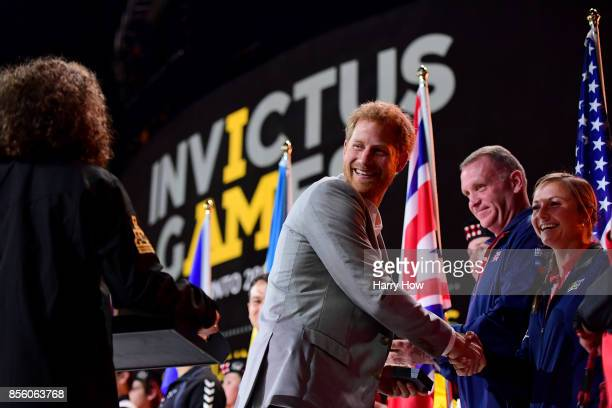 Prince Harry shakes hands with flag bearer Christy Wise of the United States during the closing ceremony of the Invictus Games 2017 at Air Canada...