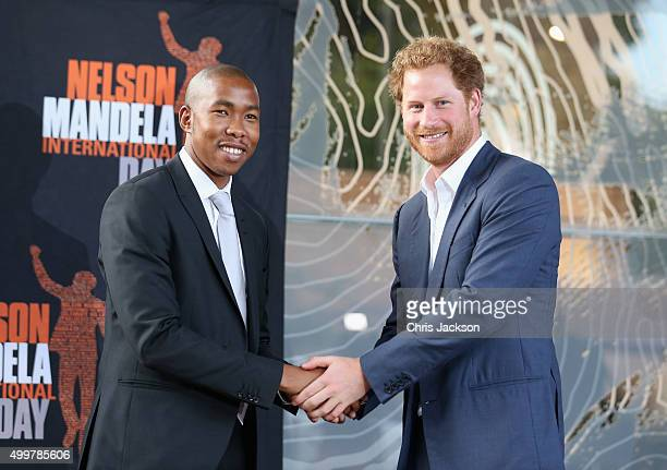 Prince Harry shakes the hand of Nelson Mandela's grandson Mbuso Mandela at the Nelson Mandela Foundation Centre of Memory on December 3 2015 in...