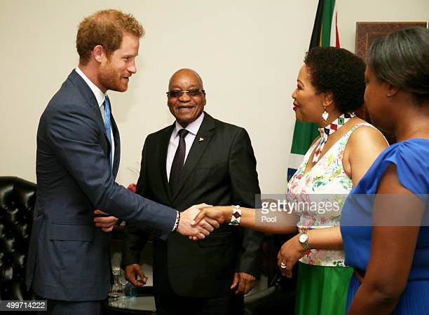Prince Harry shakes the hands with Tobeka Madiba Zuma the wife of South African President Jacob Zuma at his Official Residence on the last day of his...