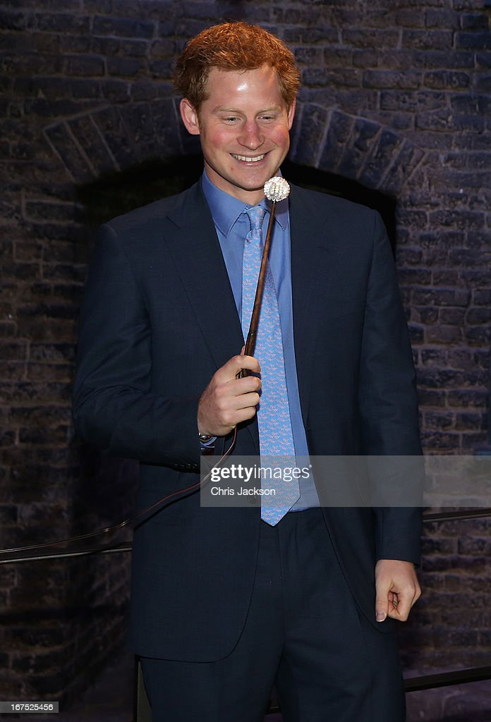 Prince Harry shares a joke on the set used to depict Diagon Alley in the Harry Potter Films during the Inauguration Of Warner Bros. Studios Leavesden on April 26, 2013 in London, England.