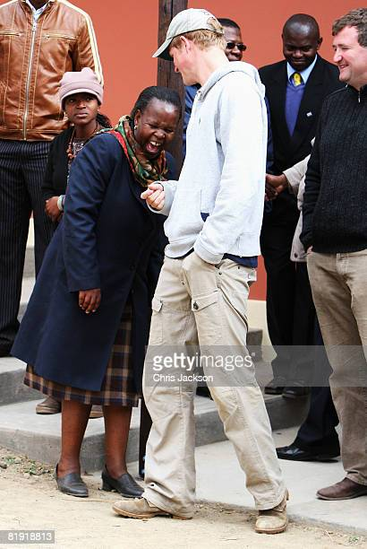 Prince Harry shares a laugh during a visit to LCCU on July 9, 2008 in Maseru, Lesotho. Prince Harry and 26 soldiers from the Household Cavalry are in...