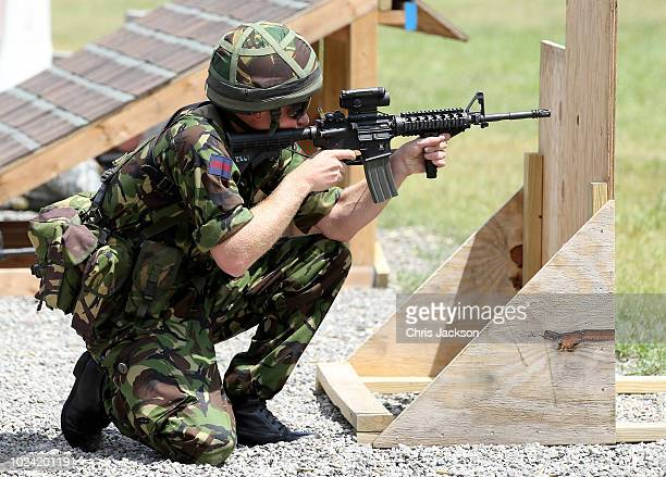 Prince Harry shoots an M4 assault rifle on the firing range at Westpoint Military Academy on June 25 2010 in New York Prince Harry is on a three day...