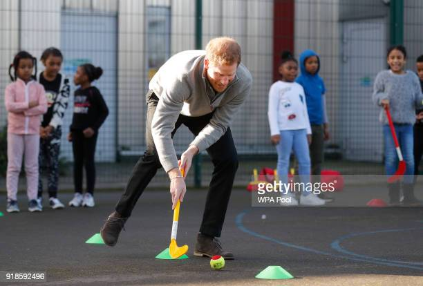 Prince Harry shows off his hockey skills as he visits a Fit and Fed February school holiday activity programme at the Roundwood Youth Centre on...