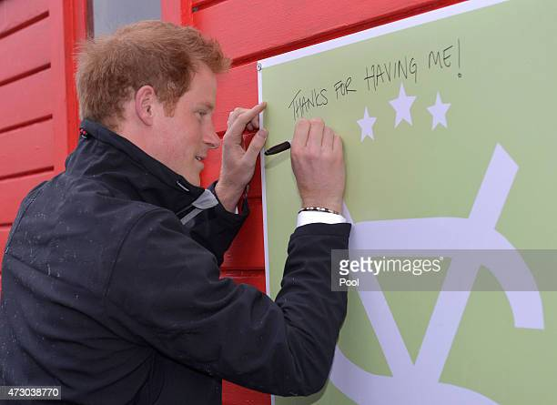 Prince Harry signs his name on a shed during a visit to the University of Canterbury in Christchurch on the latest leg of his tour of New Zealand on...