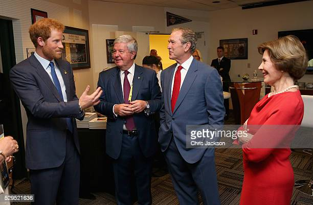 Prince Harry Sir Keith Mills George W Bush and Laura Bush chat at a reception ahead of the Opening Ceremony of the Invictus Games Orlando 2016 at...