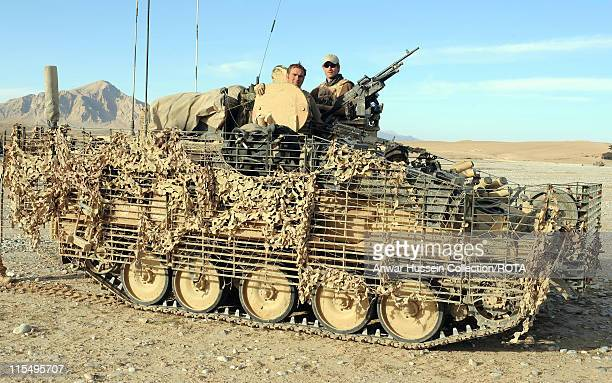 Prince Harry sits atop his Spartan armoured vehicle in the desert on February 18, 2008 in Helmand Province, Afghanistan.