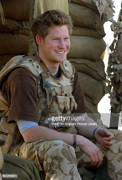 Prince Harry sits in an area of the observation post on JTAC Hill close to FOB Delhi in Helmand province on January 2 2008 in Southern Afghanistan