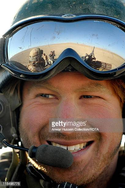 Prince Harry sits in his Spartan armoured vehicle in the desert on February 19 2008 in Helmand Province Afghanistan