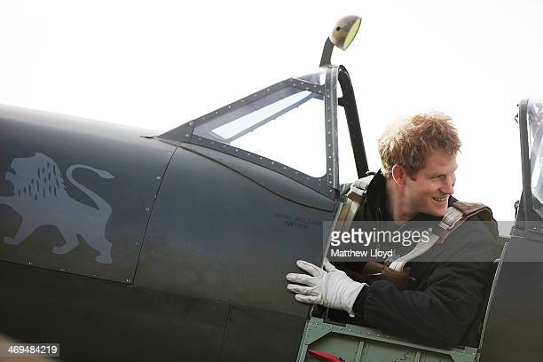 Prince Harry sits in the cockpit of a Spitfire aircraft as the engines are turned over outside a hanger at the Boultbee Flight Academy on February 15...
