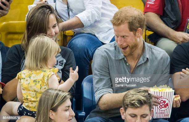 Prince Harry sits with David Henson's wife Hayley Henson and daugther Emily Henson at the Sitting Volleyball Finals on day 5 of the Invictus Games...