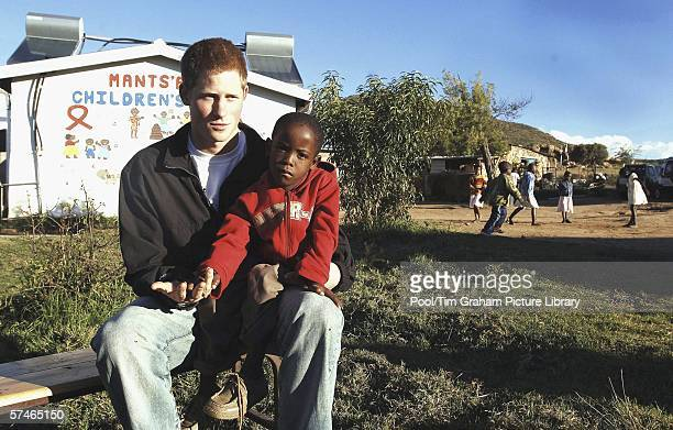 Prince Harry sits with his old friend, Mutsu Potsane, in the grounds of the Mants'ase children's home, while on a return visit to Lesotho in southern...