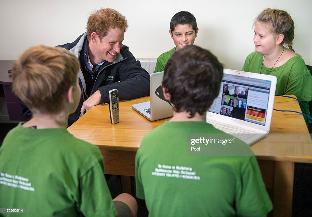 Prince Harry sits with pupils as they take part in a German lesson on Skype at Halfmoon Bay School in Oban as he leaves on May 11, 2015 in Stewart Island, New Zealand. Prince Harry is in New Zealand from May 9 through to May 16 attending events in Wellington, Invercargill, Stewart Island, Christchurch, Linton, Whanganui and Auckland.