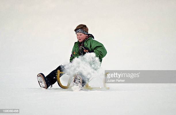 Prince Harry Sledging During A Ski Holiday In Klosters Switzerland