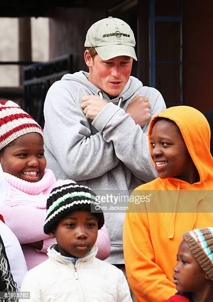 Prince Harry smiles as he poses for a photo with children during a visit to LCCU on July 9, 2008 in Maseru, Lesotho. Prince Harry and 26 soldiers...
