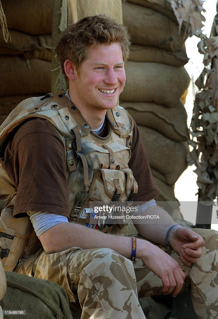 Prince Harry smiles as he sits at the observation post on JTAC Hill on January 2, 2008 in Helmand Province, Afghanistan.