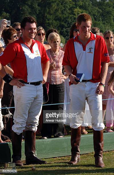 Prince Harry smiles at the presentation after playing polo the Queen Mother Trophy and Corinium Bowl Doug Brown Cup Matches at Cirencester Park Polo...