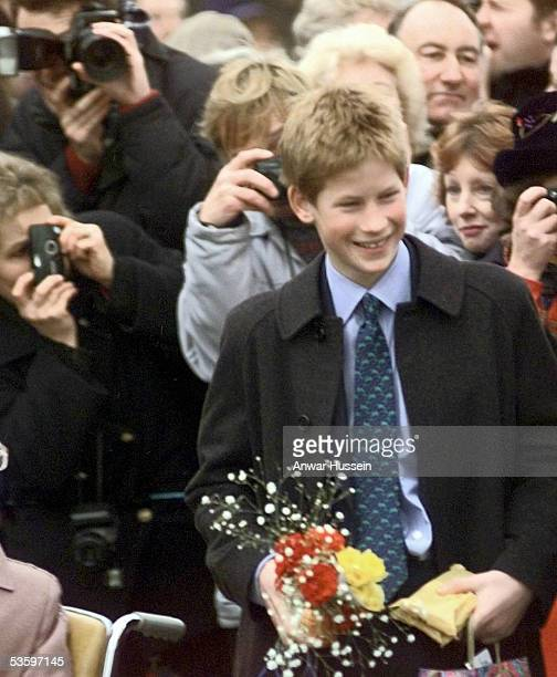Prince Harry smiles at the public following the Christmas Day church service on the Sandringham Estate on December 25 1998 in Sandringham England