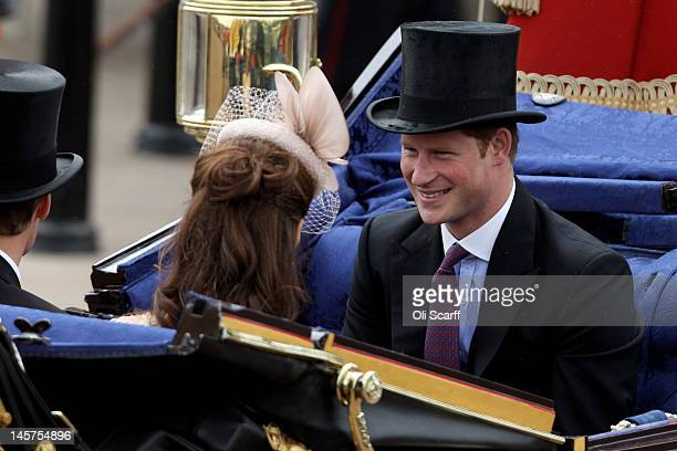 Prince Harry smiles during the Diamond Jubilee carriage procession after the service of thanksgiving at StPaul's Cathedral on The Mall on June 5 2012...