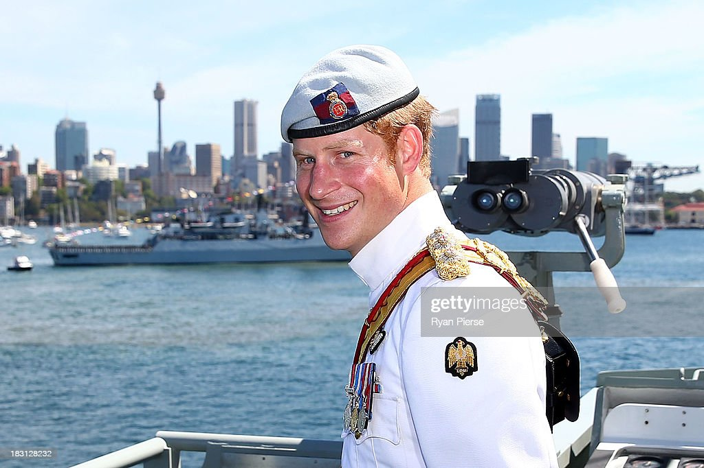 Prince Harry smiles onboard the HMAS Leeuwin during the 2013 International Fleet Review on October 5, 2013 in Sydney, Australia. Over 50 ships participate in the International Fleet Review at Sydney Harbour to commemorate the 100 year anniversary of the Royal Australian Navy's fleet arriving into Sydney. Prince Harry is an official guest of the Australian Government and will take part in the fleet review during his two-day visit to Australia.