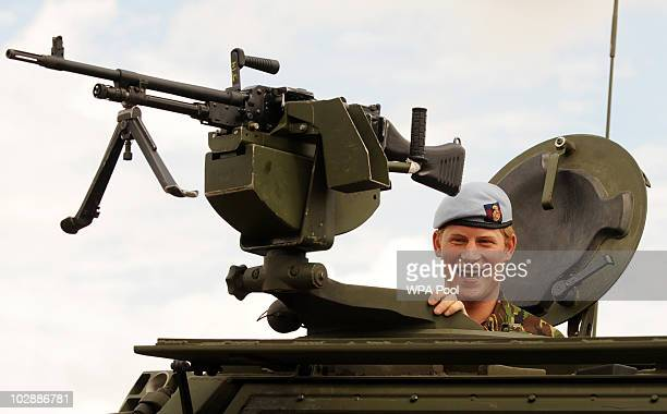 Prince Harry smiles while looking out of a Fuchs armoured vehicle during his visit to RAF Honington on July 14 2010 in Suffolk easten England During...