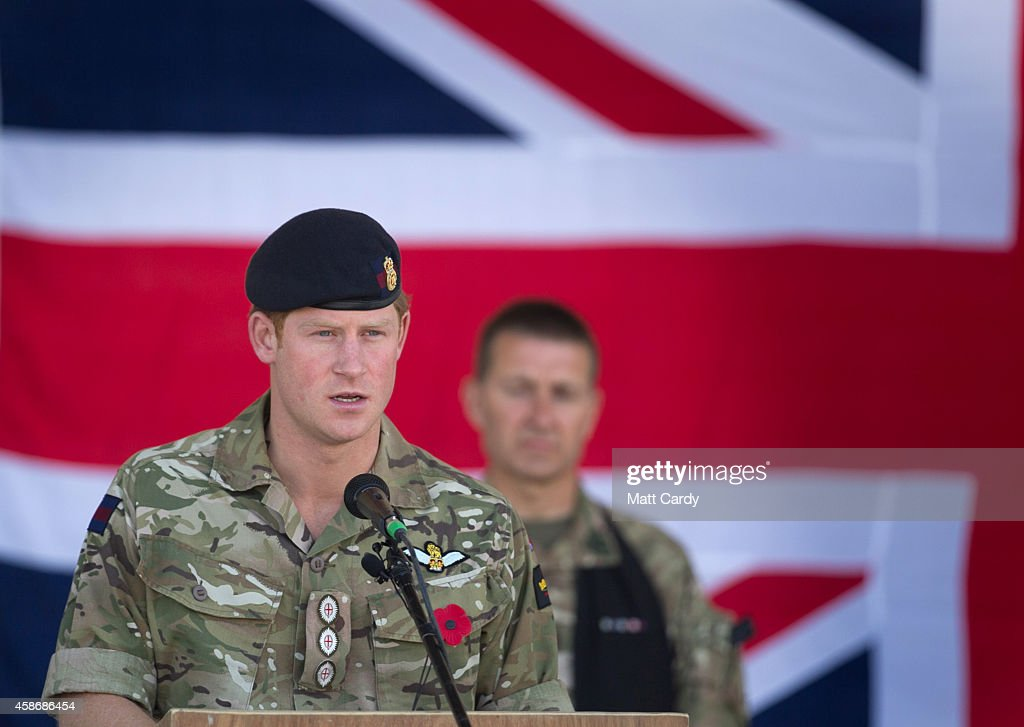 Prince Harry speaks as he joins British troops and service personal remaining in Afghanistan and International Security Assistance Force (ISAF) personnel and civilians as they gather for a Remembrance Sunday service at Kandahar Airfield November 9, 2014 in Kandahar, Afghanistan. As the UK combat mission in Afghanistan draws to an end in 2014 this year, which also marks the 100th anniversary of the start of World War One, 70 years since the D-Day landings will be the last time British service personal will gather in any great numbers in the south of the country.