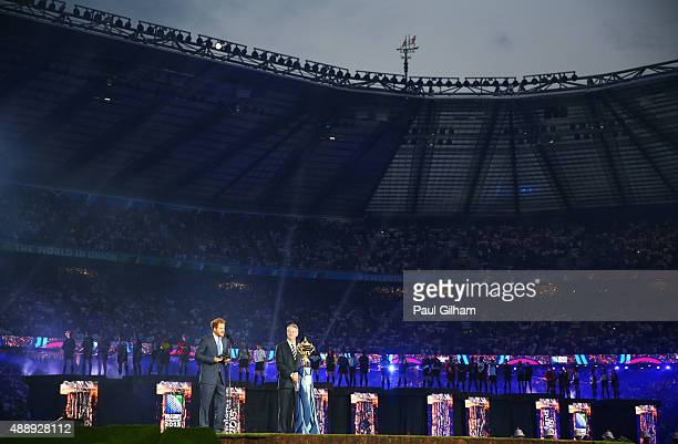 Prince Harry speaks as World Rugby Chairman Bernard Lapasset looks on during the opening ceremoy ahead of the 2015 Rugby World Cup Pool A match...