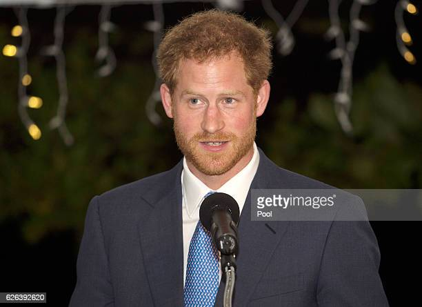 Prince Harry speaks at a reception at the Spice Island Beach Resort before attending a reception hosted by the Governor General Her Excellency Dame...