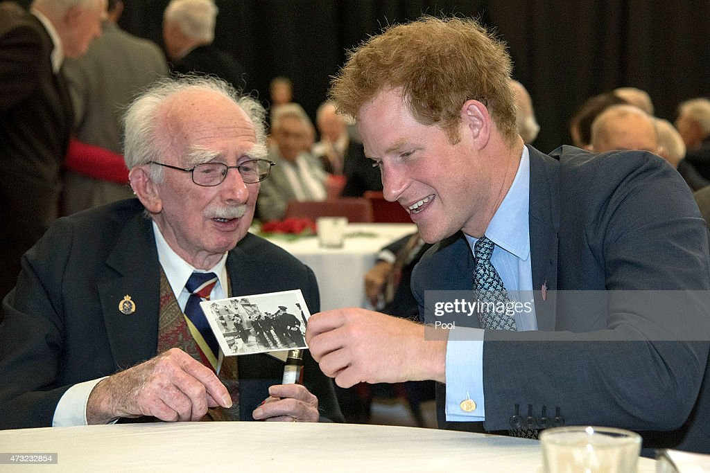 Prince Harry (R) speaks to 95 year old Kenneth Newton, a WWII veteran who met King George VI during a meet and greet at the War Memorial Centre on May 14, 2015 in Wanganui, New Zealand. Prince Harry is in New Zealand from May 9 through to May 16 attending events in Wellington, Invercargill, Stewart Island, Christchurch, Linton, Whanganui and Auckland.
