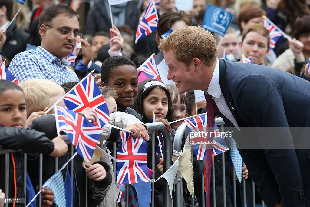 Prince Harry speaks to a group of children after arriving at Headway, the brain injury association at Bradbury House during an official visit to Nottingham on April 25, 2013 in Nottingham, England.