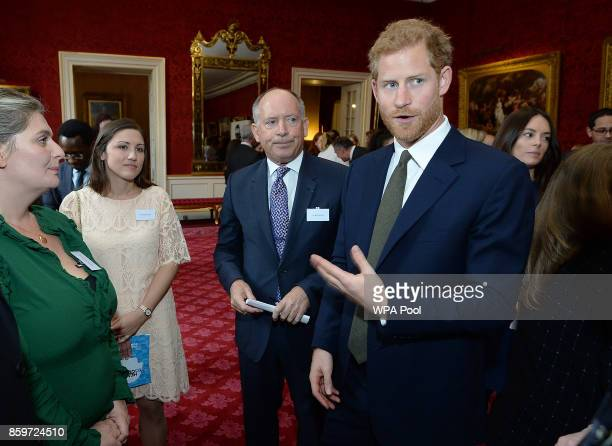 Prince Harry speaks to guests at a reception on World Mental Health Day to celebrate the impact of the Heads Together Charity at St James's Palace on...