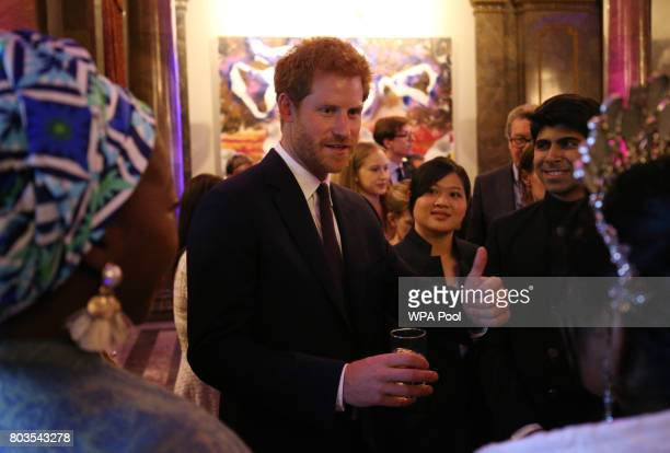 Prince Harry speaks to guests during the Queen's Young Leaders Awards Dinner at Australia House following the awards ceremony at Buckingham Palace on...