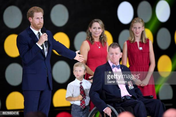 Prince Harry speaks to Retired Canadian Forces Captain Trevor Greene and family onstage during the opening ceremony on day 1 of the Invictus Games...
