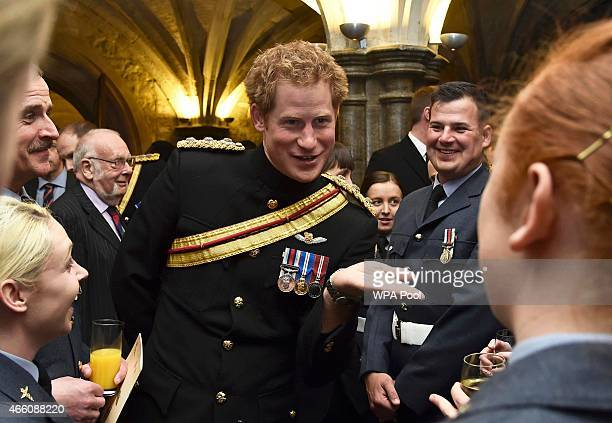 Prince Harry speaks with armed forces personnel during a reception at Guildhall after the Afghanistan service of commemoration at St Paul's Cathedral...