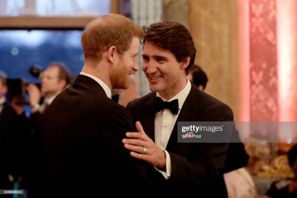Prince Harry speaks with Canadian Prime Minister Justin Trudeau during a reception for the Queen's Dinner for the Commonwealth Heads of Government Meeting (CHOGM) at Buckingham Palace on April 19, 2018 in London, England.