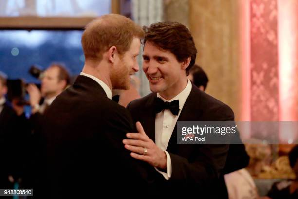 Prince Harry speaks with Canadian Prime Minister Justin Trudeau during a reception for the Queen's Dinner for the Commonwealth Heads of Government...