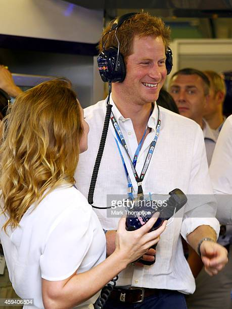 Prince Harry speaks with Geri Halliwell in the Infiniti Red Bull Racing garage during qualifying for the Abu Dhabi Formula One Grand Prix at Yas...