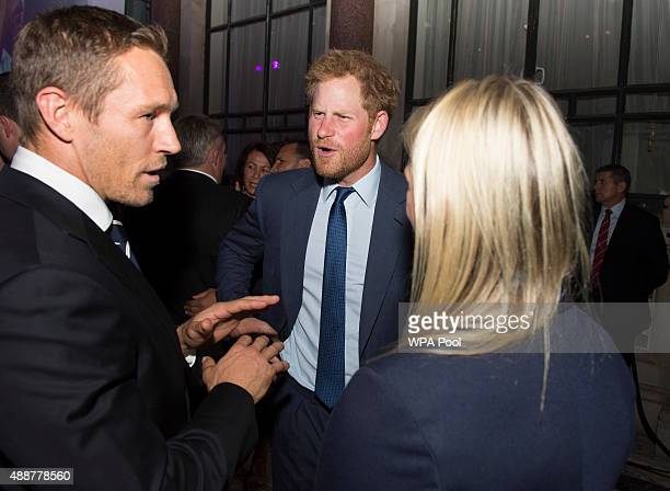 Prince Harry speaks with Jonny Wilkinson at the Rugby World Cup 2015 welcome party hosted by the Rugby Football Union at Durbar Court The Foreign...