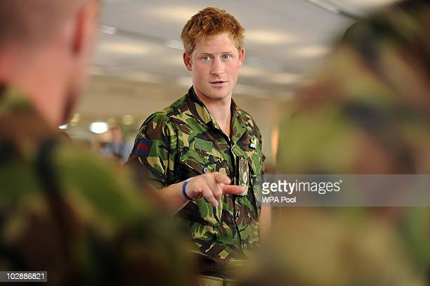 Prince Harry speaks with RAF personnel during his visit to RAF Honington on July 14 2010 in Suffolk easten England During his visit Prince Harry was...