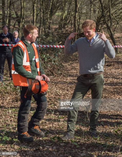 Prince Harry speaks with Sam hobbs who showed the Prince his prosthetic foot an injury he sustained while serving with the Parachute Regiment while...