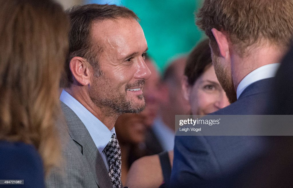 Prince Harry speaks with Tim McGraw at the Invictus Games 2016 Reception at the British Ambassador's Residence on October 28, 2015 in Washington, DC.