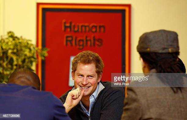 Prince Harry speaks with youngsters involved in a film project during a visit to the Full Effect Youth Project on February 3 2015 in Nottingham...