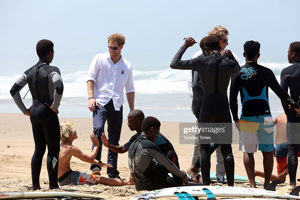 Prince Harry spends time with surfers of Surfers Not Street Children on December 1, 2015 at in Durban, South Africa. Earlier, the British Royal visited the Kings Park Stadium and played tag rugby with children against a team led by former Springbok captain John Smit.