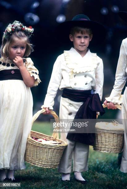 Prince Harry stands beside his cousin Eleanor Fellowes as he acts as a pageboy at the wedding of his uncle Charles Spencer on September 17 1989 in...