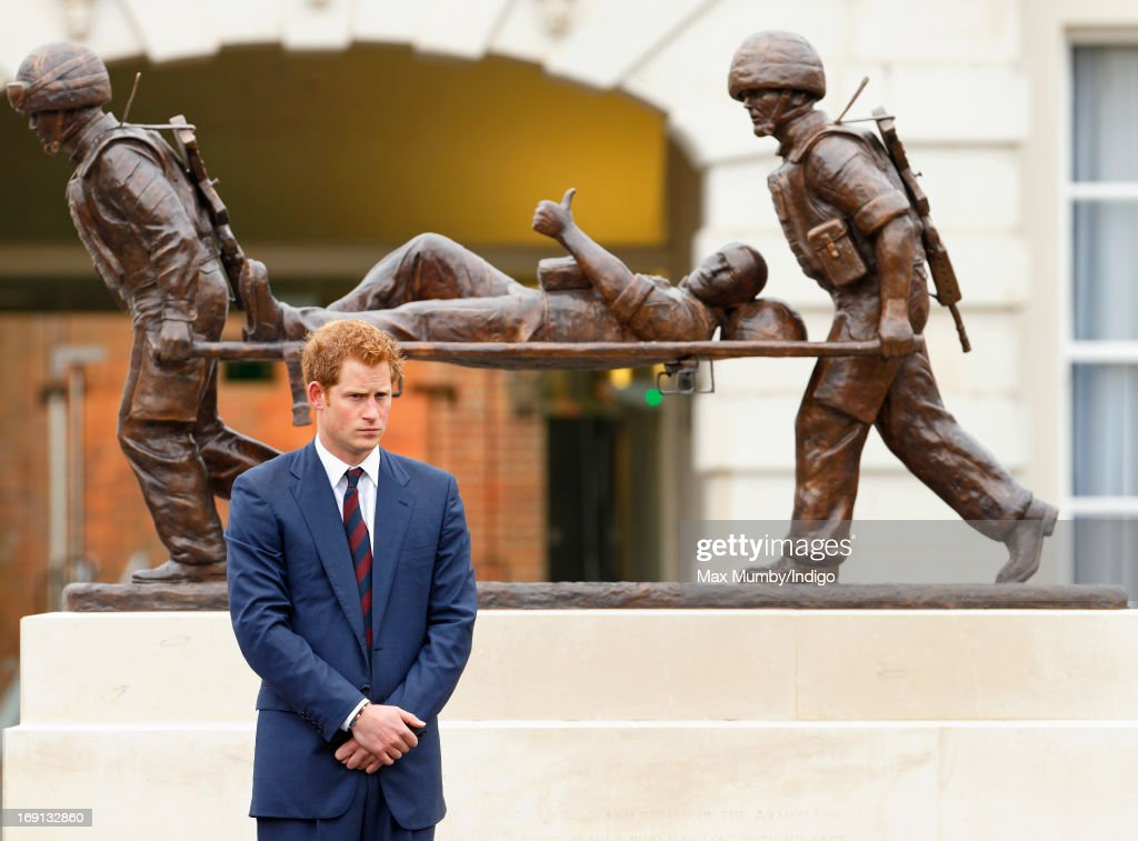 Prince Harry stands in front of the Help for Heroes statue as he attends the opening of the new Help for Heroes Recovery Centre at Tedworth House on May 20, 2013 in Tidworth, England. During their visit the two Royal Princes met with wounded veterans, serving personnel, and their families. Tedworth House in Wiltshire is one of four new units in England which will offer respite care and rehabilitation to injured and sick service personnel, veterans and their families.