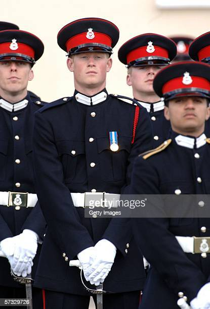 Prince Harry stands to attention at his passing-out Sovereign's Parade at Sandhurst Military Academy on April 12, 2006 in Sandhurst, England.
