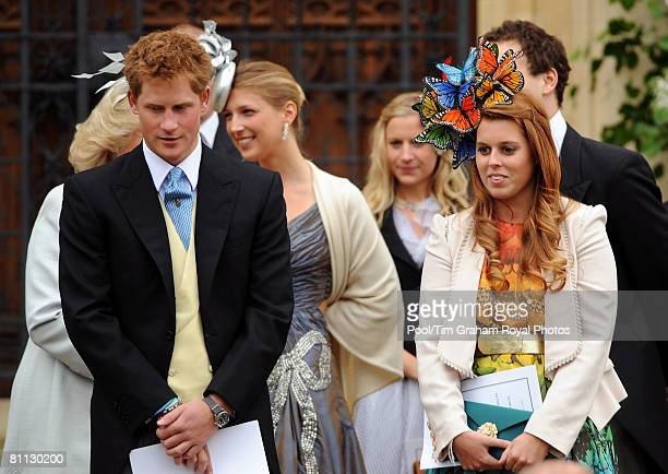 Prince Harry stands with cousin Princess Beatrice at the wedding of Peter Phillips to Autumn Kelly, at St George's Chapel in Windsor Castle on May...